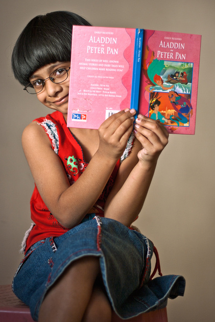 Image 2: My daughter Mansi posing while reading.